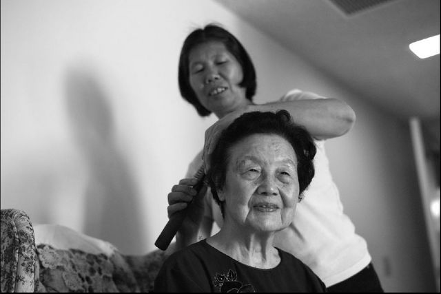 Poo's elderly maternal grandmother with her Asian American home-care worker