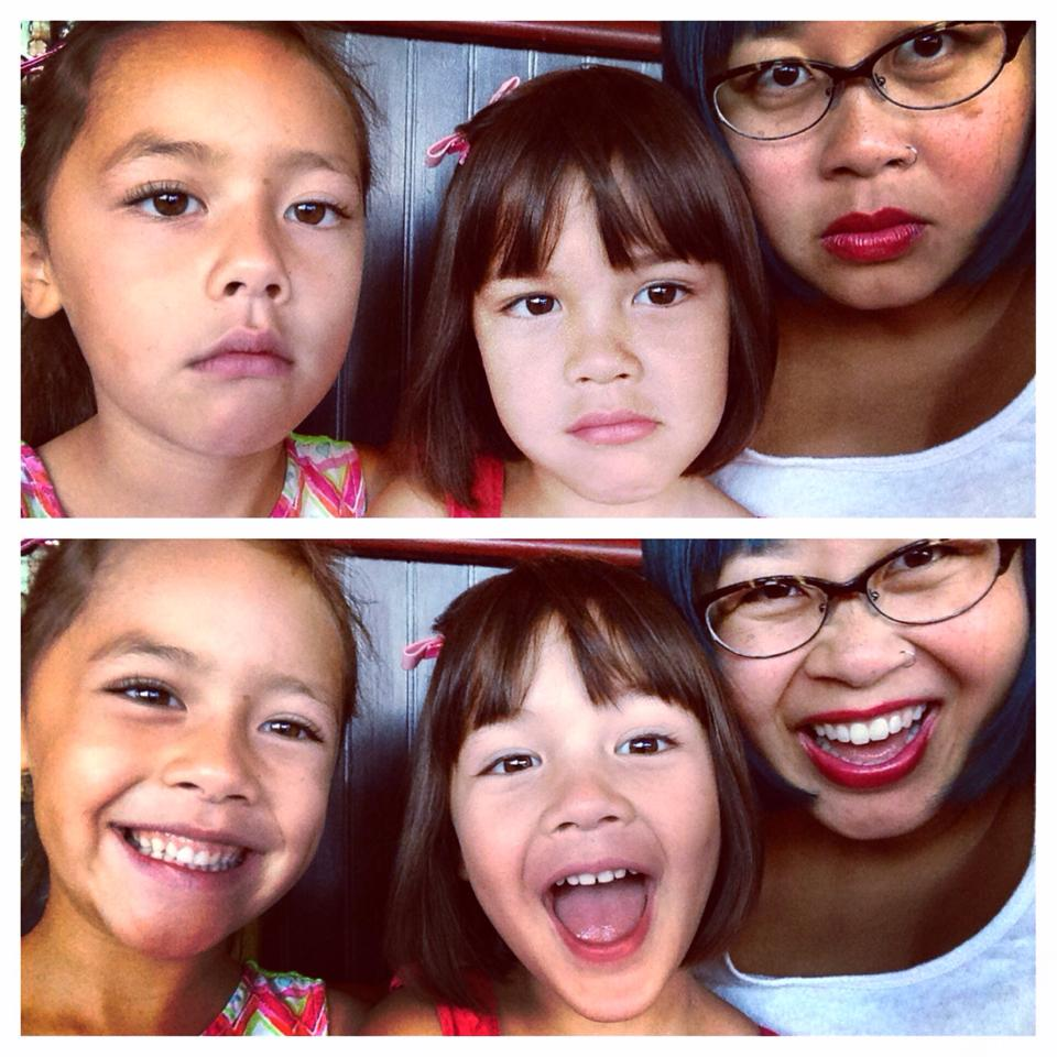 Two selfies: both of a 6-year-old, a 4-year-old, and an adult with glasses and red lipstick. In the top image, they gaze seriously at the camera. In the second, they grin with open mouths, like they just heard a hilarious joke.