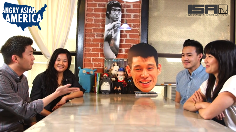 Phil Yu, Jenny Yang, and others gather around a table to host an episode of Angry Asian America on ISATV, and hub of Asian American independent media content.