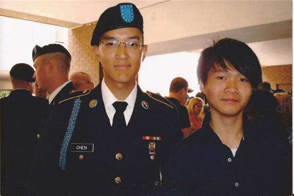 The author, Banny Chen, stands with his cousin, Danny Chen, who is dressed in military uniform.